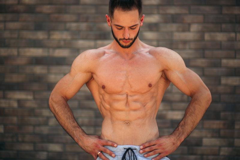 bodybuilder flexing upper body muscles
